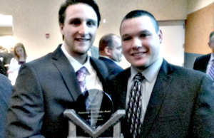 Matt Cotiguala (left) poses with two-time former Fred Mitchell Award winner Tom Lynch from Saint Xavier University.